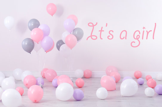 Baby shower party for girl. Room decorated with balloons