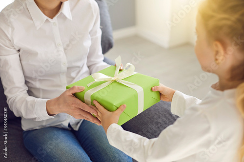 Happy mother's day. Hands of a child give mother a present on mother's day.