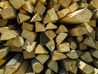 Small pieces of firewoods neatly stacked as combustible for winter