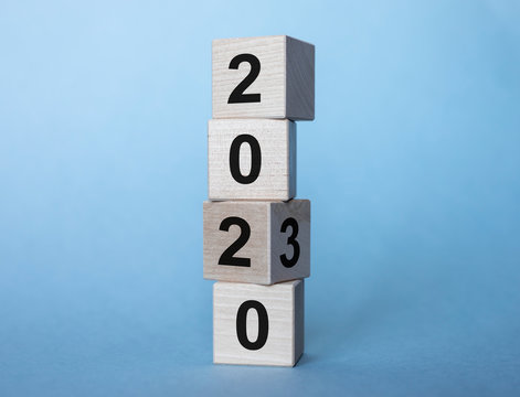 2020 and 2030 years on wooden cubes on a light blue background