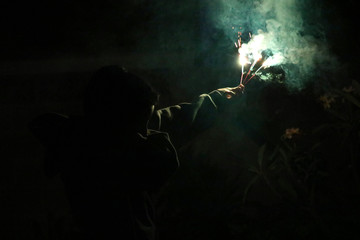 Cropped Image Of Person Holding Firework During Night