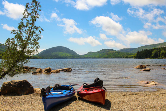 Kayaks At Beach Against Cloudy Sky During Sunny Day At Acadia National Park