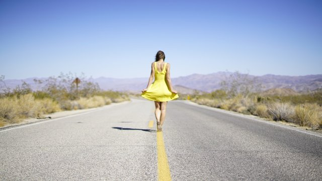 Woman Dancing On Country Road
