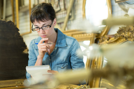 portrait of female antiquarian reading her notes