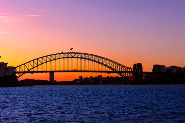 Fotobehang Sydney Panoramic view of Sydney Harbour with all the vibrant colours on a orange and blue sunset afternoon