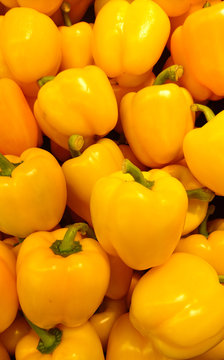 Full Frame Shot Of Yellow Bell Peppers For Sale At Market