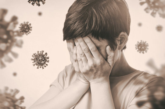 Concept of fear of coronavirus. Woman covers her face her hands on background with coronavirus.