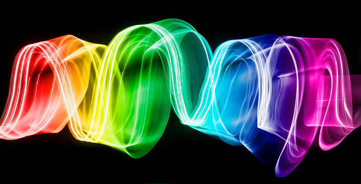 Multi Colored Light Paintings Against Black Background