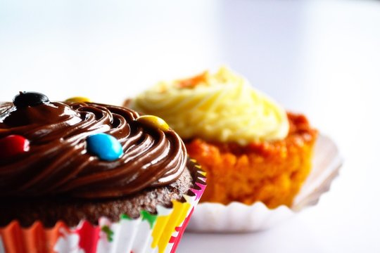Low Angle View Of Cupcakes Against White Background