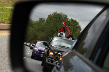 Activists organized by Black Lives Matter hold a rally at low speed in their cars as they highlight essential workers in underprivileged communities in Washington