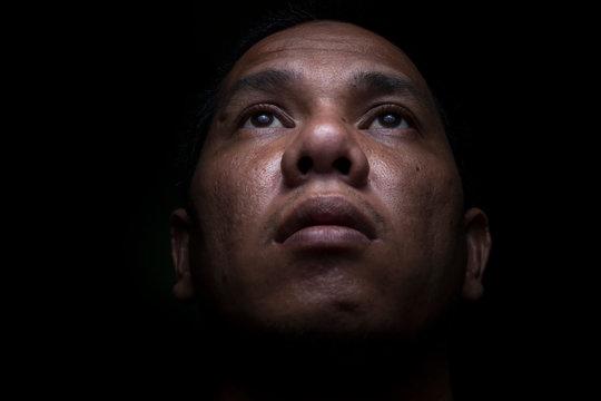 Portrait Of Man Over Black Background