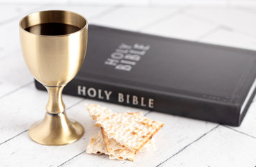 Holy Communion or the Lords Supper on a White Wooden Table