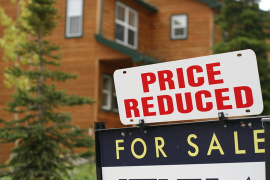 Home For Sale Price Reduced Sign during  slowing economy