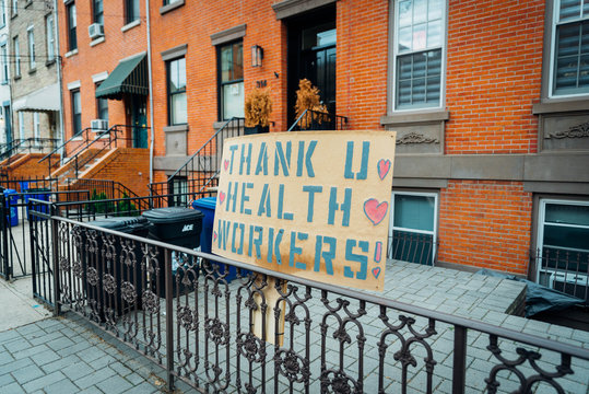 Hoboken, NJ - April 27 2020: A sign in the street in front of a brownstone that reads thank u healthcare workers you raising spirits Coronavirus COVID-19 pandemic epidemic fighting