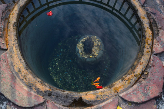 High Angle View Of Coins In Religious Well