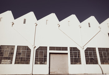Old-fashioned storage industrial building with closed roller door