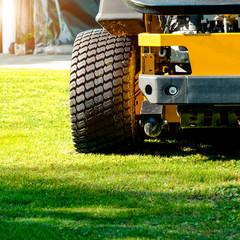 Lawn mower park in green grass field, zero turn Lawn mower.