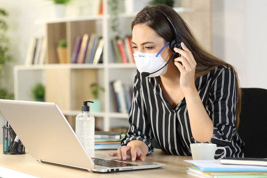 Telemarketer with laptop working at home due covid-19