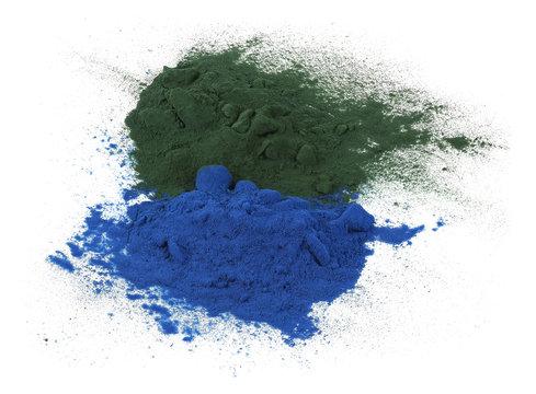 Green and blue spirulina powder isolated on white background
