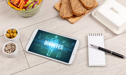 DIABETES concept in tablet with fruits, top view