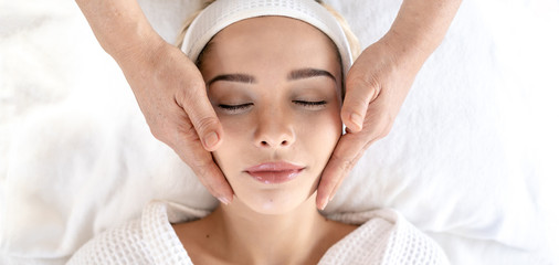 Woman Relaxes in the Spa Body massage Treatment.