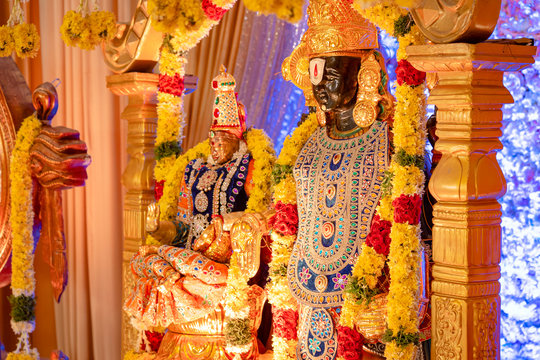 The idol of Lord Balaji and Lakshmi decorated with ornaments and flowers at a South-Indian Hindu wedding