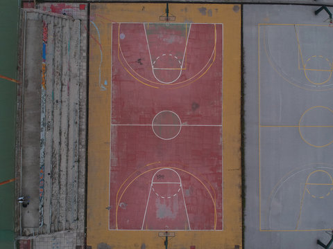Aerial drone shot over basketball courts in a sports complex in Poseidonio, Thessaloniki Greece