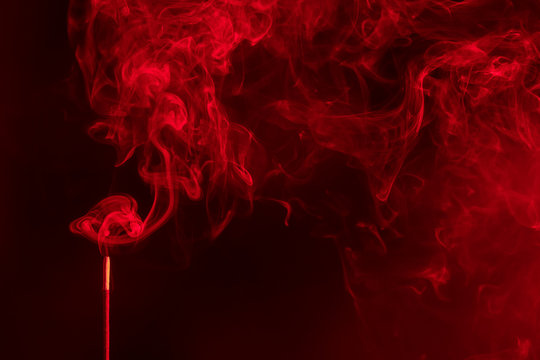Aroma sticks incense with realistic smoke. Indian aromatherapy and meditation ,red colour.