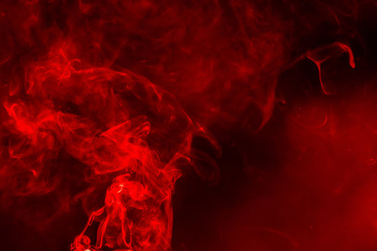 Abstract Smoke on black Background, red colour.