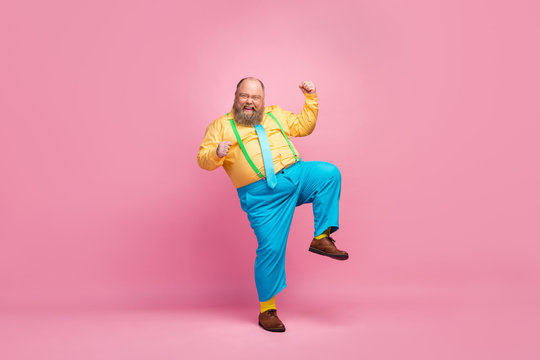 Full length body size view of his he nice funky crazy carefree positive glad bearded guy dancing having fun good mood rejoicing isolated over pink pastel color background