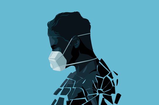 A fractured self isolated man wearing a face mask in the Covid-19 crisis. mental health, stress and anxiety caused by the outbreak of coronavirus.