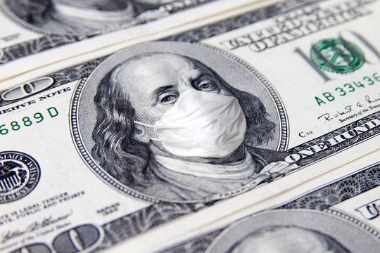 One Hundred Dollar money bill. Benjamin Franklin with face medical mask. COVID-19 coronavirus USA, Economy world crisis.