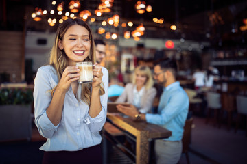 Wall Mural - Portrait of happy beautiful business woman on coffee breakdoor
