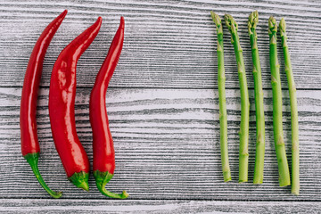 pepper and asparagus on a white table. Fruits and vegetables on a wooden background. Food photography