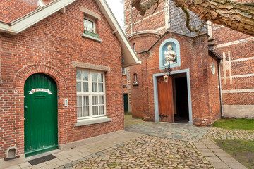 Doors of monastery of historical city area, 13th century Beguinage houses for beguines women
