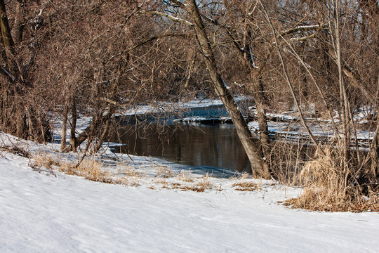 East branch of the Rock River flows through Mayville, Wisconsin  following a recent February snowfall