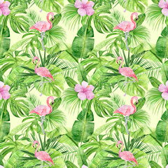 Watercolor illustration seamless pattern of tropical leaves and pink flamingo. Perfect as background texture, wrapping paper, textile or wallpaper design. Hand drawn