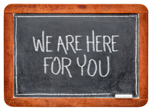we are here for you blackboard sign with chalk