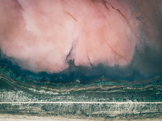 Aerial view of Koyashs'ke lake with pink salt under the water on the Crimean peninsula, Republic of Crimea, Russia.