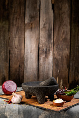 Fototapete - Traditional molcajete to make Mexican sauce with vegetables