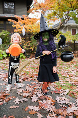 Boy and girl in Halloween costumes