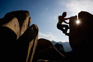 Female climber bouldering at Seroksan national park in South Korea