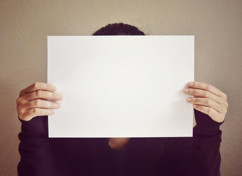 Close-up Of Woman Holding Paper