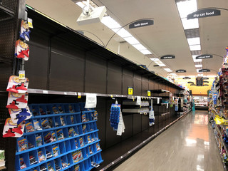 Shelves are left empty at a Kroger-owned Ralphs store after it sold out of toilet paper in Los Angeles, California