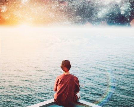 Digital Composite Image Of Man Sitting On Pier Against Stars