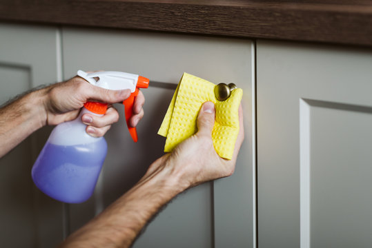 Corona virus protection, closeup disinfecting surfaces with disinfectant, stay home and safe, avoid contamination with covid 19