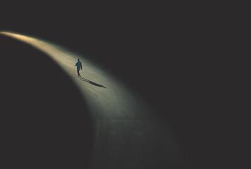 Obraz man walking in the night - fototapety do salonu