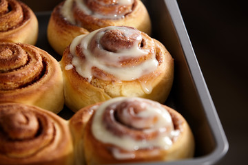 Fresh bakery. Cinnamon rolls are oiled.