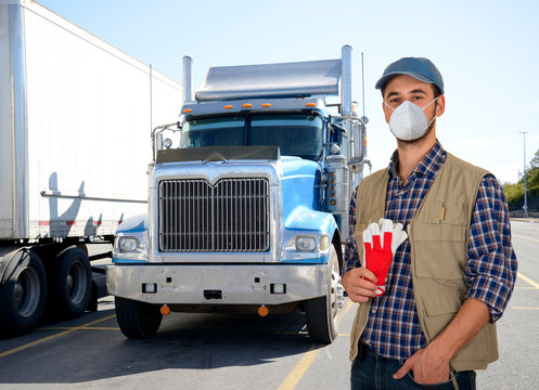 Truck driver with protective mask during coronavirus