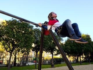 Happing girl having fun in swing